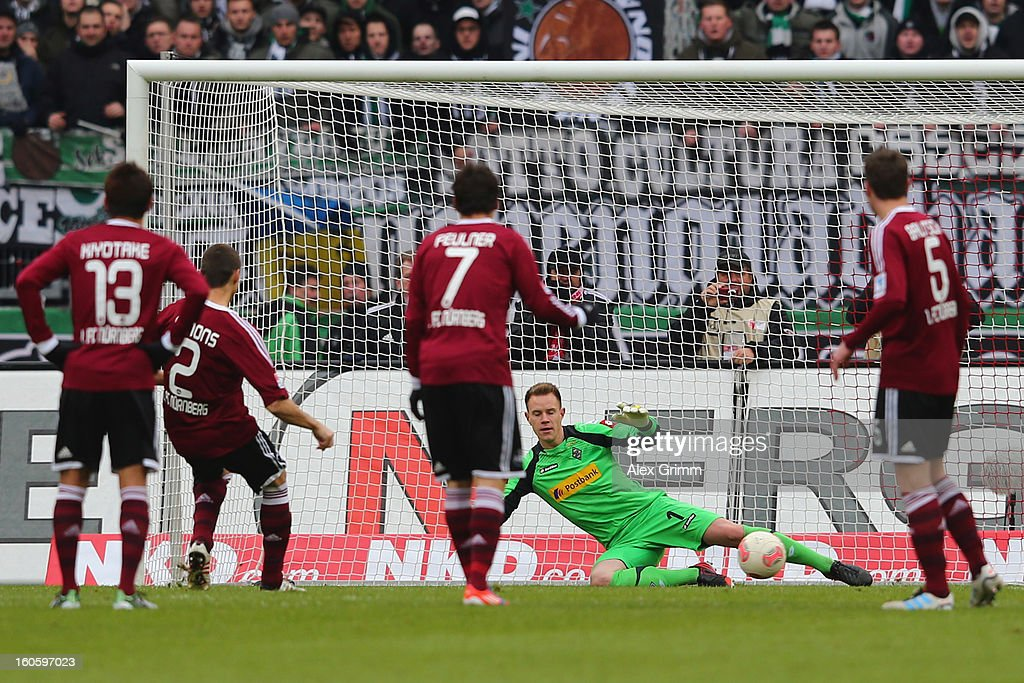 Timmy Simons (2L) of Nuernberg scores his team's first goal with a penalty against goalkeeper <a gi-track='captionPersonalityLinkClicked' href=/galleries/search?phrase=Marc-Andre+ter+Stegen&family=editorial&specificpeople=5528638 ng-click='$event.stopPropagation()'>Marc-Andre ter Stegen</a> of Moenchengladbach during the Bundesliga match between 1. FC Nuernberg and VfL Borussia Moenchengladbach at Easy Credit Stadium on February 3, 2013 in Nuremberg, Germany.