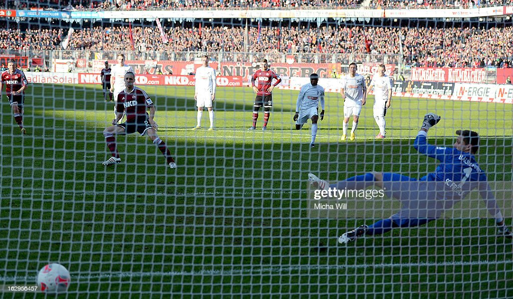 Timmy Simons of Nuernberg scores the first goal from the penalty spot during the Bundesliga Match between 1. FC Nuernberg and SC Freibug at Grundig Stadion on March 2, 2013 in Nuremberg, Germany.