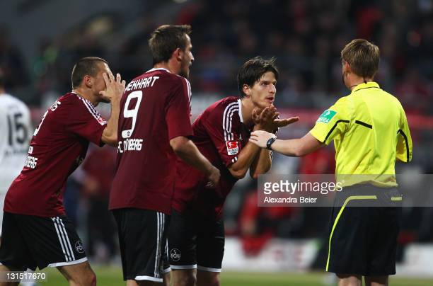 Timmy Simons Tomas Peckhart and Timm Klose of Nuernberg react after a decision against a goal by referee Christian Dingert during the Bundesliga...