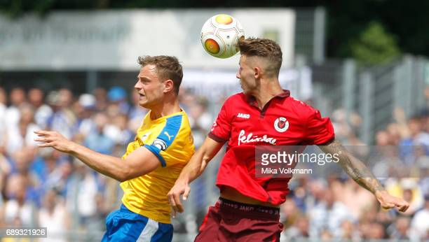 Timmy Thiele of Jena jumps for a header against Dominik Lanius of Viktoria Koeln during the Third League Plaffoff match between Viktoria Koeln and FC...
