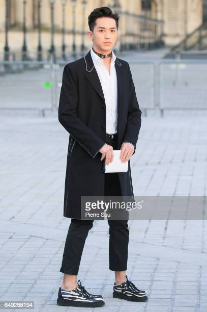Timmy Xu Weizhou arrives at the Louis Vuitton show as part of the Paris Fashion Week Womenswear Fall/Winter 2017/2018 on March 7 2017 in Paris France