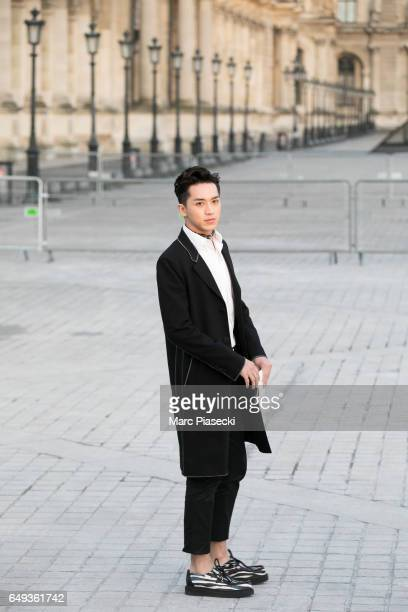 Timmy Xu Weizhou attends the Louis Vuitton show as part of the Paris Fashion Week Womenswear Fall/Winter 2017/2018 on March 7 2017 in Paris France