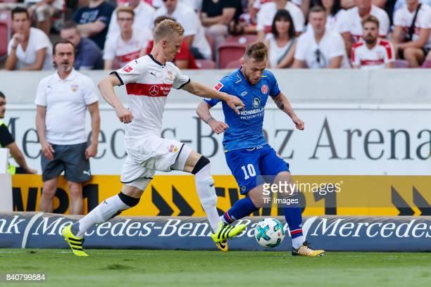 Timo Baumgartl of Stuttgart and Alexandru Maxim of Mainz battle for the ball during the Bundesliga match between VfB Stuttgart and 1FSV Mainz 05 at...