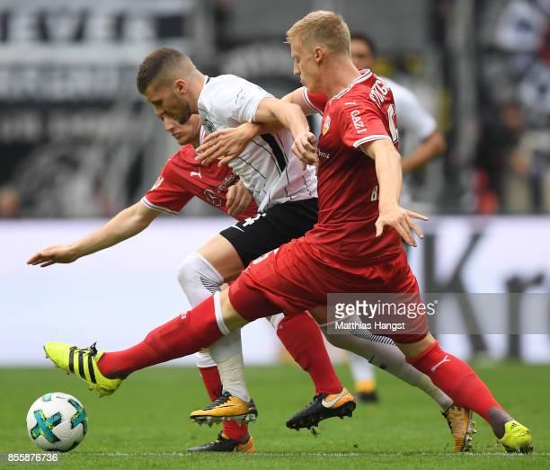 Timo Baumgartl of Stuttgart Ante Rebic of Frankfurt and Santiago Ascacibar of Stuttgart during the Bundesliga match between Eintracht Frankfurt and...