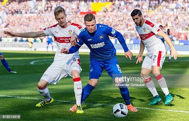 Timo Baumgartl of Stuttgart challenges Florian Kamberi of Karlsruhe during the Second Bundesliga match between Karlsruher SC and VfB Stuttgart at...