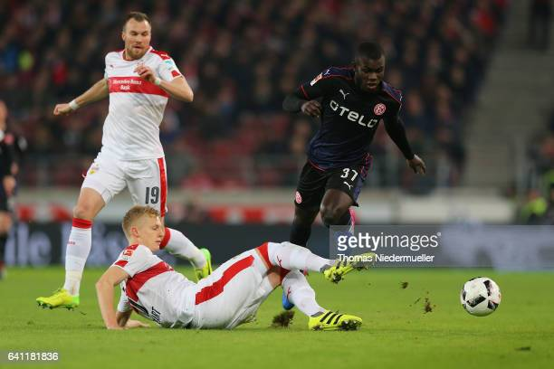 Timo Baumgartl of Stuttgart fights for the ball with Ihlas Bebou of Duesseldorf during the Second Bundesliga match between VfB Stuttgart and Fortuna...