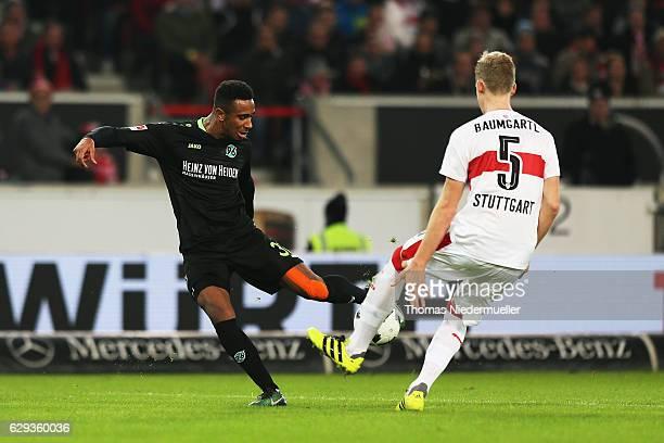 Timo Baumgartl of Stuttgart fights for the ball with Noah Joel Sarenren Bazee of Hannover during the Second Bundesliga match between VfB Stuttgart...