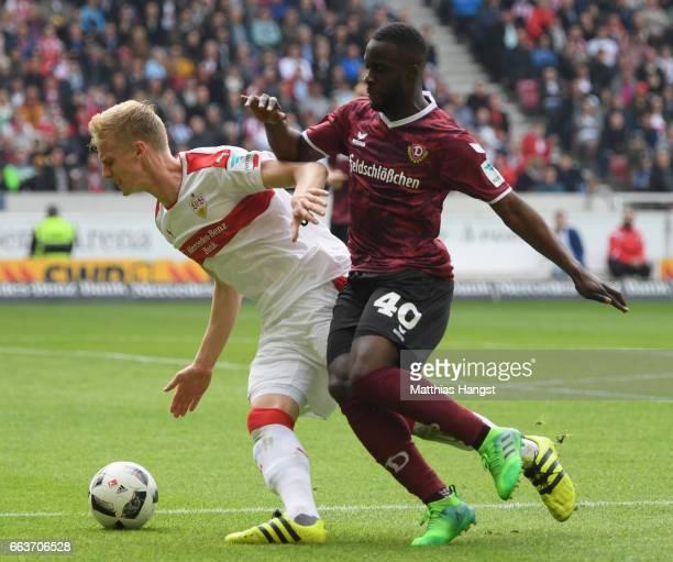 Timo Baumgartl of Stuttgart is challenged by Erich Berko of Dresden during the Second Bundesliga match between VfB Stuttgart v Dynamo Dresden at...