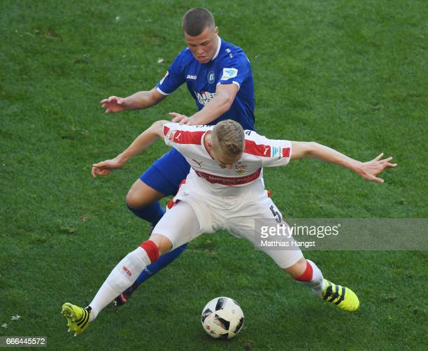 Timo Baumgartl of Stuttgart is challenged by Florian Kamberi of Karlsruhe during the Second Bundesliga match between VfB Stuttgart and Karlsruher SC...