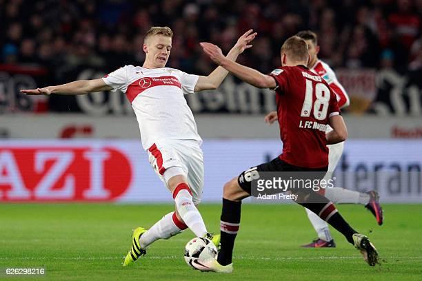 Timo Baumgartl of Stuttgart is challenged by Hanno Behrens of Nuernberg during the Second Bundesliga match between VfB Stuttgart and 1 FC Nuernberg...