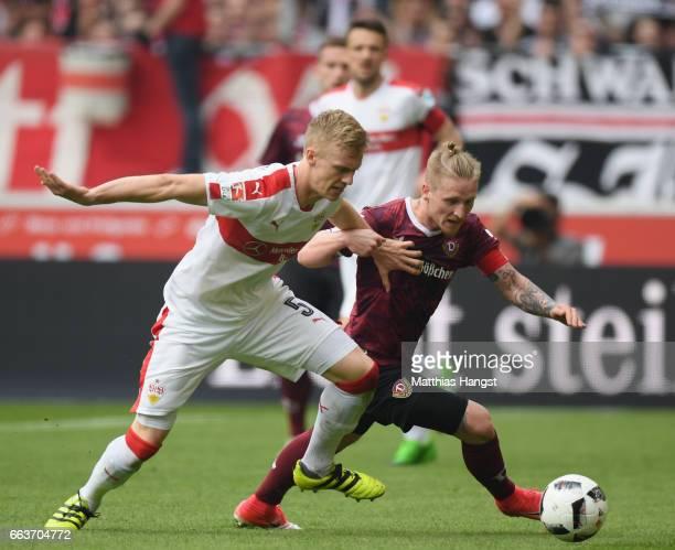 Timo Baumgartl of Stuttgart is challenged by Marvin Stefaniak of Dresden during the Second Bundesliga match between VfB Stuttgart v Dynamo Dresden at...