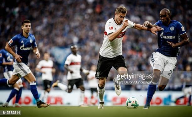 Timo Baumgartl of Stuttgart is challenged by Naldo of Schalke during the Bundesliga match between FC Schalke 04 and VfB Stuttgart at VeltinsArena on...