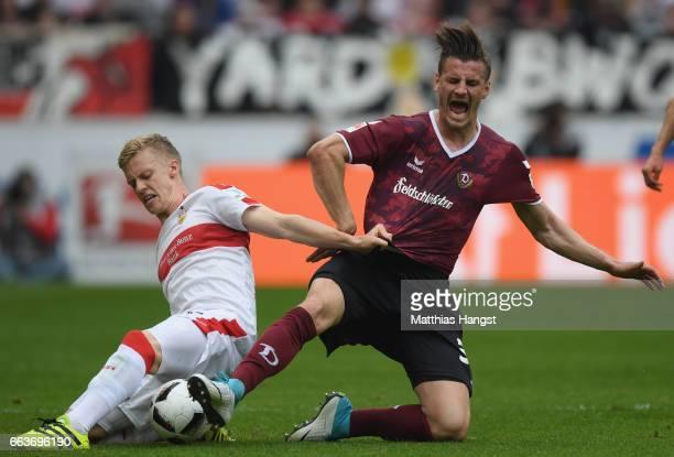 Timo Baumgartl of Stuttgart is challenged by Stefan Kutschke of Dresden during the Second Bundesliga match between VfB Stuttgart v Dynamo Dresden at...