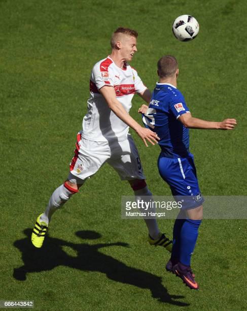 Timo Baumgartl of Stuttgart jumps for a header with Florian Kamberi of Karlsruhe during the Second Bundesliga match between VfB Stuttgart and...