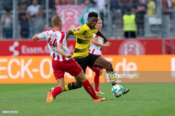 Timo Becker of Essen and DanAxel Zagadou of Dortmund battle for the ball during the preseason friendly match between RotWeiss Essen and Borussia...