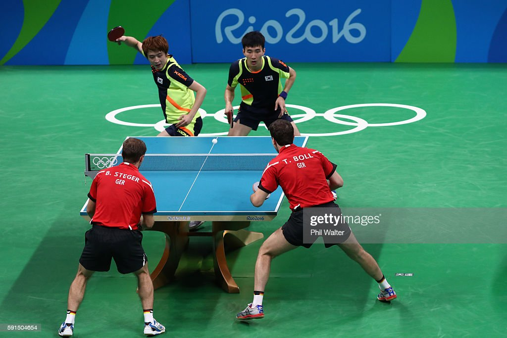 Timo Boll and Bastian Steger of Germany play Youngsik Jeoung and Saehyuk Joo of Korea during the Men's Team Bronze Medal match between Korea and Germany at the Rio Centro Pavilion on August 17, 2016 in Rio de Janeiro, Brazil.