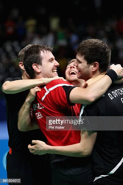 Timo Boll Bastian Steger and Dimitrij Ovtcharov of Germany celebrate the Bronze Medal during the Men's Team Bronze Medal match between Korea and...