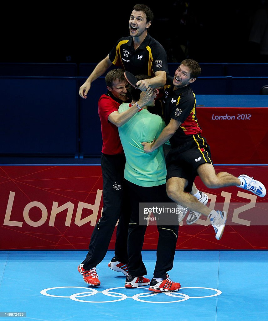 Timo Boll (top) of Germany and team celebrate Boll defeating Tianyi Jiang of Hong Kong, China and winning the Men's Team Table Tennis bronze medal match on Day 12 of the London 2012 Olympic Games at ExCeL on August 8, 2012 in London, England.