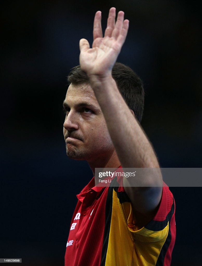 Timo Boll of Germany celebrates after his Men's Singles Table Tennis third round match against Noshad Alamiyan of Islamic Republic of Iran on Day 3 of the London 2012 Olympic Games at ExCeL on July 30, 2012 in London, England.