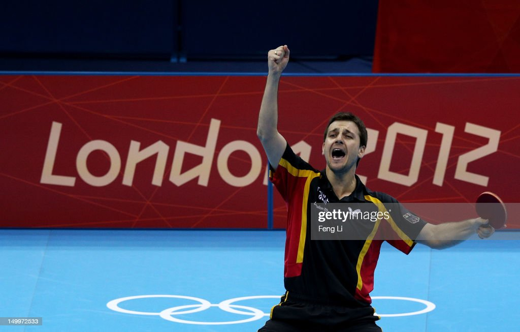 Timo Boll of Germany celebrates defeating Tianyi Jiang of Hong Kong, China and winning the Men's Team Table Tennis bronze medal match on Day 12 of the London 2012 Olympic Games at ExCeL on August 8, 2012 in London, England.
