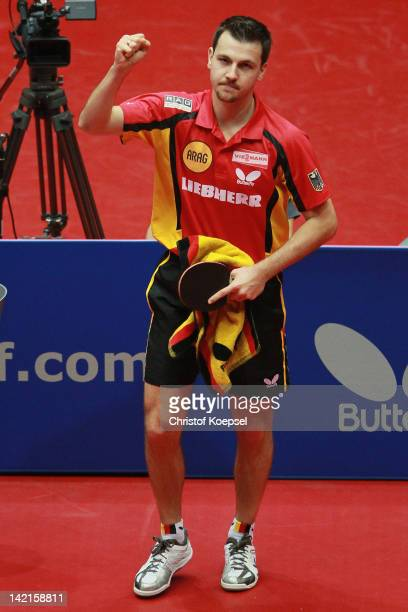 Timo Boll of Germany celebrates his victory after his match against Koki Niwa of Japan during the LIEBHERR table tennis team world cup 2012...