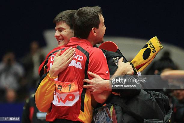 Timo Boll of Germany celebrates his victory with Dimitrij Ovtcharov after his match against Jun Mizutani of Japan during the LIEBHERR table tennis...