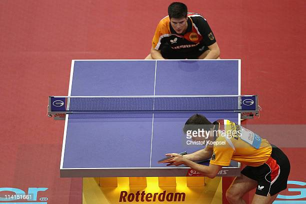 Timo Boll of Germany d serves during the Round of 16 Men's Single match between Dimitrij Ovtcharov of Germany and Timo Boll of Germany during the...