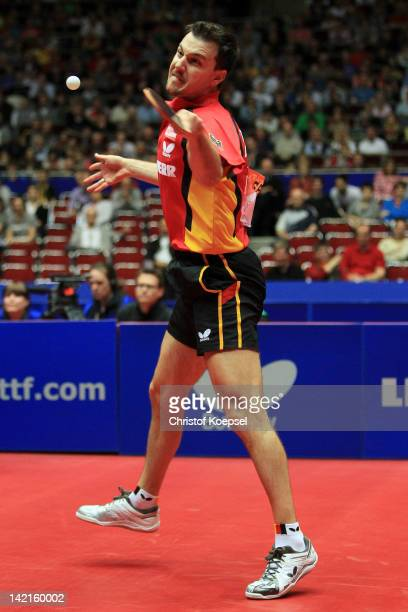 Timo Boll of Germany plays a forehand during his match against Jun Mizutani of Japan during the LIEBHERR table tennis team world cup 2012...