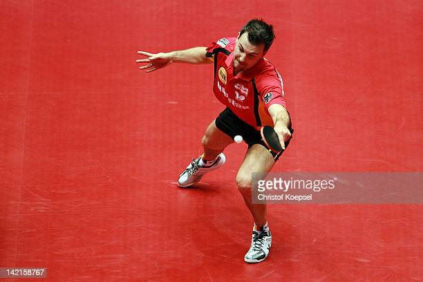 Timo Boll of Germany plays a forehand during his match against Koki Niwa of Japan during the LIEBHERR table tennis team world cup 2012 championship...