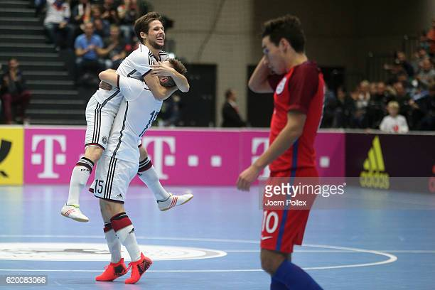 Timo di Gorgio of Germany celebrates with his team mate Adam Fiedler after scoring his team's second goal during the Futsal International Friendly...