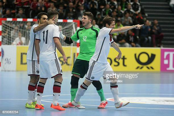 Timo di Gorgio of Germany celebrates with his team mates after scoring his team's second goal during the Futsal International Friendly match between...