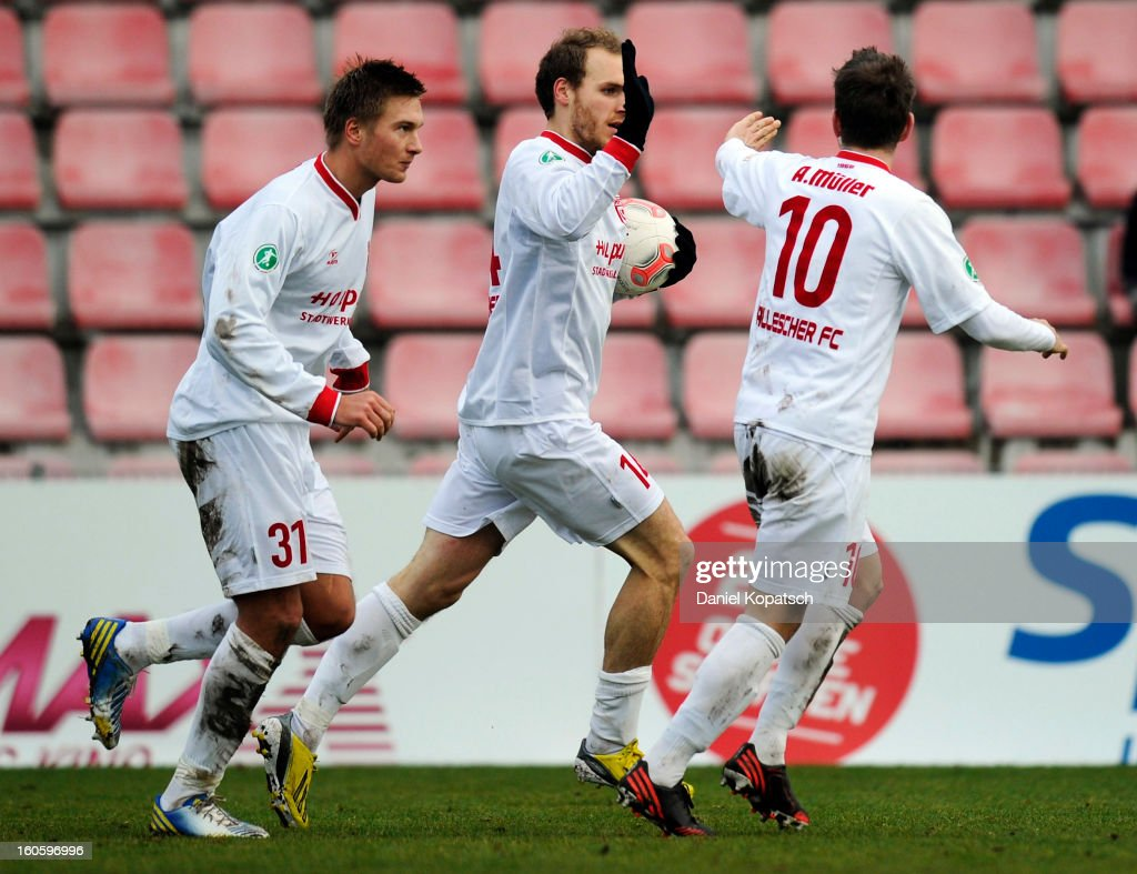 Timo Furuholm of Halle (C) celebrates his team's first goal with team mates Kristian Kojola (L) and <a gi-track='captionPersonalityLinkClicked' href=/galleries/search?phrase=Anton+Mueller&family=editorial&specificpeople=4161961 ng-click='$event.stopPropagation()'>Anton Mueller</a> during the third Bundesliga match between SpVgg Unterhaching and Hallescher FC on February 3, 2013 in Unterhaching, Germany.