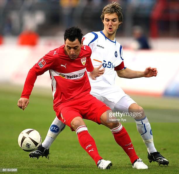 Timo Gebhart of Stuttgart and Christian Eichner of Karlsruhe battle for the ball during the Bundesliga match between Karlsruher SC and VfB Stuttgart...