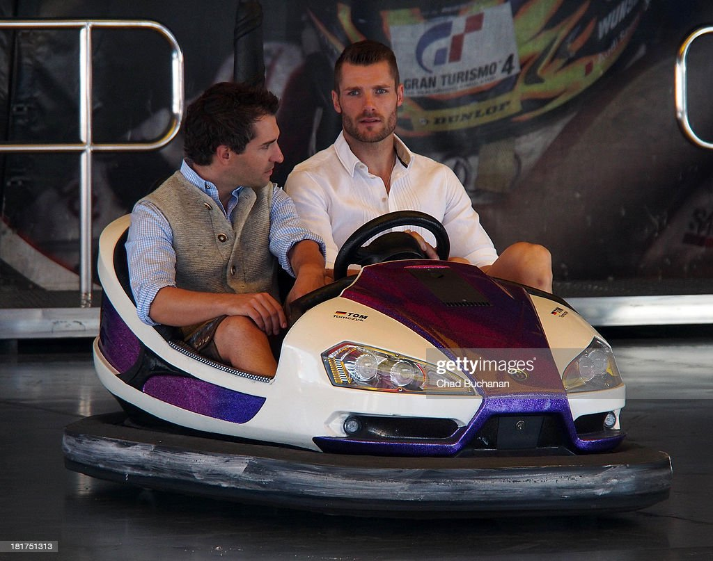 <a gi-track='captionPersonalityLinkClicked' href=/galleries/search?phrase=Timo+Glock&family=editorial&specificpeople=239199 ng-click='$event.stopPropagation()'>Timo Glock</a> and <a gi-track='captionPersonalityLinkClicked' href=/galleries/search?phrase=Martin+Tomczyk&family=editorial&specificpeople=726723 ng-click='$event.stopPropagation()'>Martin Tomczyk</a> sighting at Theresienwiese on September 24, 2013 in Munich, Germany.