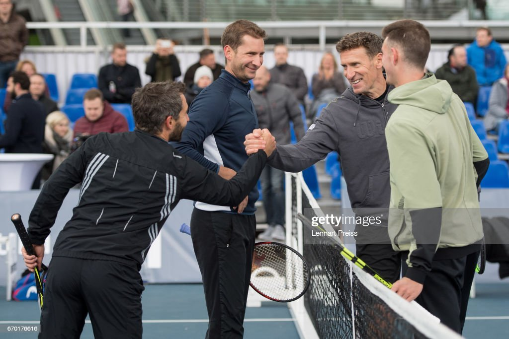 Timo Glock (L-R), DTM race driver, Florian Mayer, Patrik Kuehnen, tournament director BMW Open and Maximilian Marterer shake hands after the BMW Open Show Match at Airport Munich on April 19, 2017 in Munich, Germany.