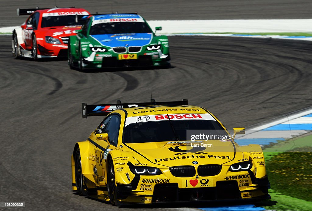 <a gi-track='captionPersonalityLinkClicked' href=/galleries/search?phrase=Timo+Glock&family=editorial&specificpeople=239199 ng-click='$event.stopPropagation()'>Timo Glock</a> of Germany and BMW Team MTEK drives during the first round of the DTM 2013 German Touring Car Championship at Hockenheimring on May 5, 2013 in Hockenheim, Germany.