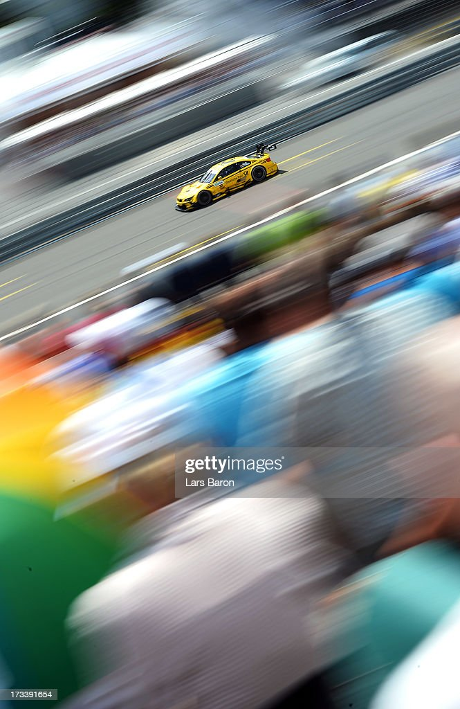 <a gi-track='captionPersonalityLinkClicked' href=/galleries/search?phrase=Timo+Glock&family=editorial&specificpeople=239199 ng-click='$event.stopPropagation()'>Timo Glock</a> of Germany and BMW Team MTEK drives during the qualifying for the fifth round of the DTM 2013 German Touring Car Championship at Norisring on July 13, 2013 in Nuremberg, Germany.