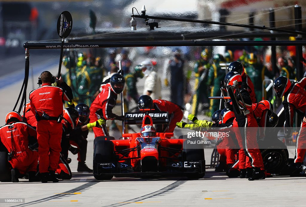 <a gi-track='captionPersonalityLinkClicked' href=/galleries/search?phrase=Timo+Glock&family=editorial&specificpeople=239199 ng-click='$event.stopPropagation()'>Timo Glock</a> of Germany and Marussia stops for a pitstop during the United States Formula One Grand Prix at the Circuit of the Americas on November 18, 2012 in Austin, Texas.