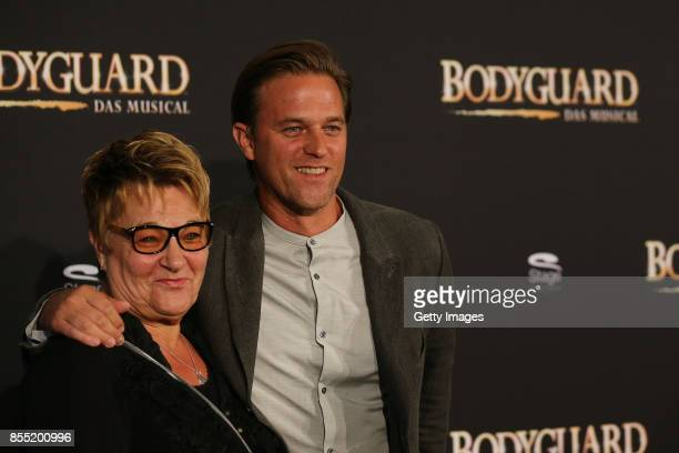Timo Hildebrand and Karin Hildebrand attend the black carpet at the 'Bodyguard Das Musical' premiere at Stage Palladium Theater on September 28 2017...