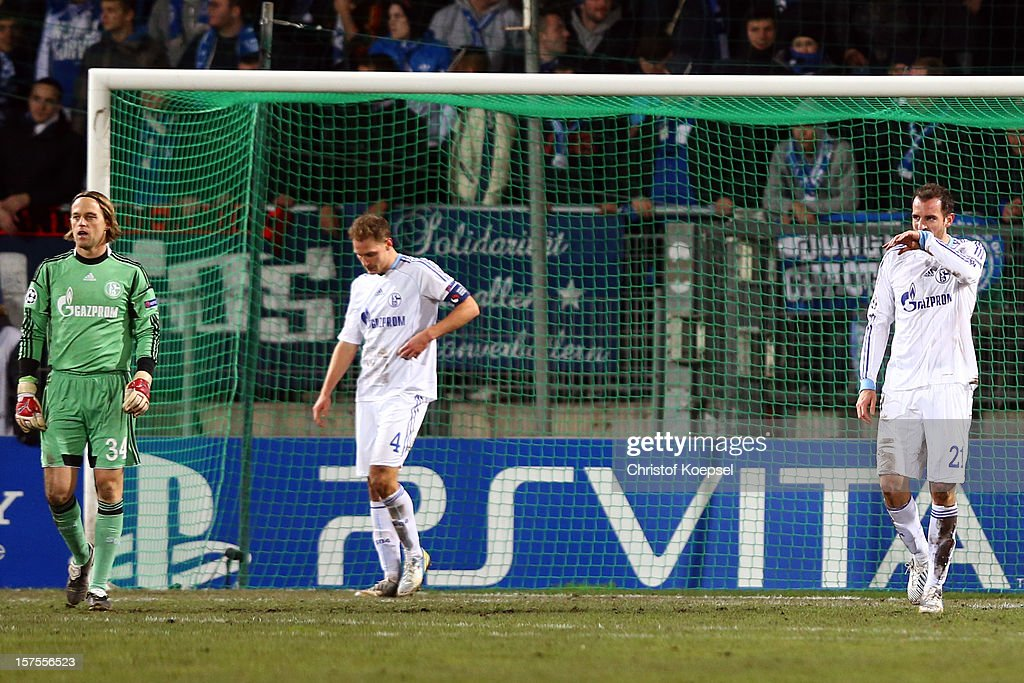Timo Hildeb,rand Benedikt Hoewedes and Christoph Metzelder of Schalke look dejected after the first goal of Montpellier during the UEFA Champions League group B match between Montpellier Herault SC and FC Schalke 04 at Stade de la Mosson on December 4, 2012 in Montpellier, France.