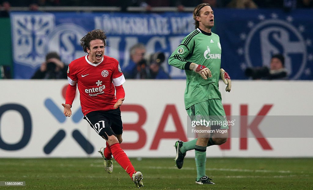 <a gi-track='captionPersonalityLinkClicked' href=/galleries/search?phrase=Timo+Hildebrand&family=editorial&specificpeople=212953 ng-click='$event.stopPropagation()'>Timo Hildebrand</a> (R) of Schalke looks on and <a gi-track='captionPersonalityLinkClicked' href=/galleries/search?phrase=Nicolai+Mueller&family=editorial&specificpeople=2344337 ng-click='$event.stopPropagation()'>Nicolai Mueller</a> (L) of Mainz celebrates after winning the DFB cup round of sixteen match between FC Schalke 04 and FSV Mainz 05 at Veltins-Arena on December 18, 2012 in Gelsenkirchen, Germany.