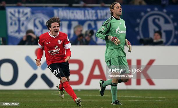 Timo Hildebrand of Schalke looks on and Nicolai Mueller of Mainz celebrates after winning the DFB cup round of sixteen match between FC Schalke 04...