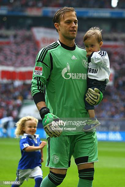 Timo Hildebrand of Schalke walks off the pitch with his son prior to the Bundesliga match between FC Schalke 04 and VfB Stuttgart at VeltinsArena on...