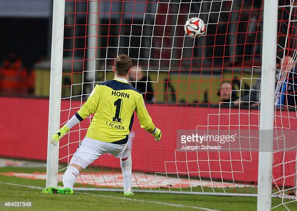 Timo Horn of Cologne eyes the ball when Hannover scores the first goal during the Bundesliga match between 1 FC Koeln and Hannover 96 at...