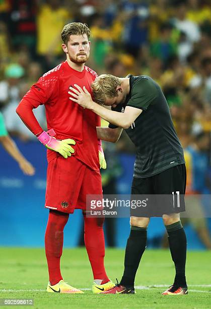 Timo Horn of Germany and team mate Julian Brandt of Germany react after losing in the penalty shoot out during the Men's Football Final between...