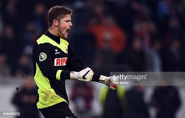 Timo Horn of Koeln celebrates with team mates after winning the DFB Cup second round match between MSV Duisburg and 1 FC Koeln at...