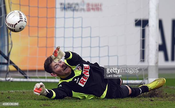 Timo Horn of Koeln saves one of two penalties during the DFB Cup second round match between MSV Duisburg and 1 FC Koeln at SchauinslandReisenArena on...