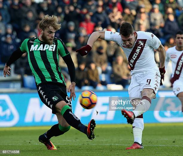 Timo Letschert of Sassuolo competes for the ball with Andrea Belotti of Torino during the Serie A match between US Sassuolo and FC Torino at Mapei...