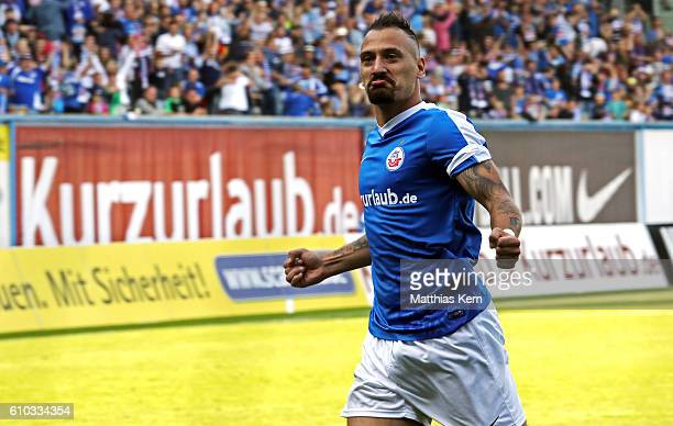 Timo Martin Gebhardt of Rostock jubilates after scoring the first goal during the third league match between FC Hansa Rostock and FSV Zwickau at...
