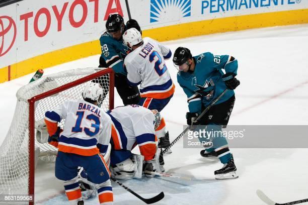Timo Meier and Joonas Donskoi of the San Jose Sharks with Mathew Barzal and Nick Leddy of the New York Islanders battle around the net as Thomas...